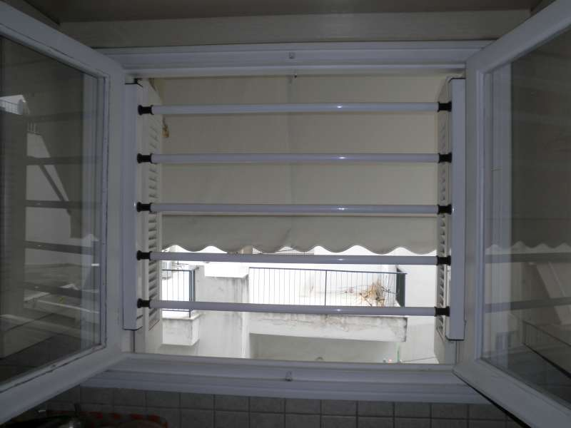 Viometaloumin retractable security doors security bars for Retractable windows and doors
